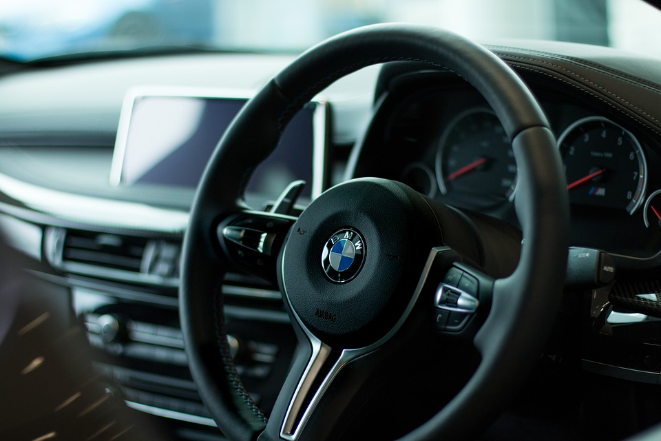 Photo of the inside of a BMW vehicle with dashboard in background